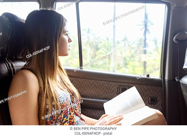 Young woman looking out of taxi window, Tagbilaran, Bohol Province, Philippines
