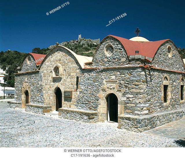 Greece, Rhodes, Dodecanese, Asklipion, Kimisis tis Theotoku church, castle ruins in background
