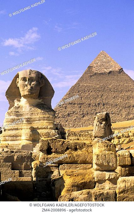 EGYPT, CAIRO, GIZA, SPHINX WITH CHEOPS PYRAMID IN BACKGROUND