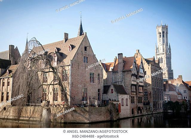 Belfry of Bruges towers over the buildings at the junction of the Groenerei and Dijver canals, Bruges, Belgium
