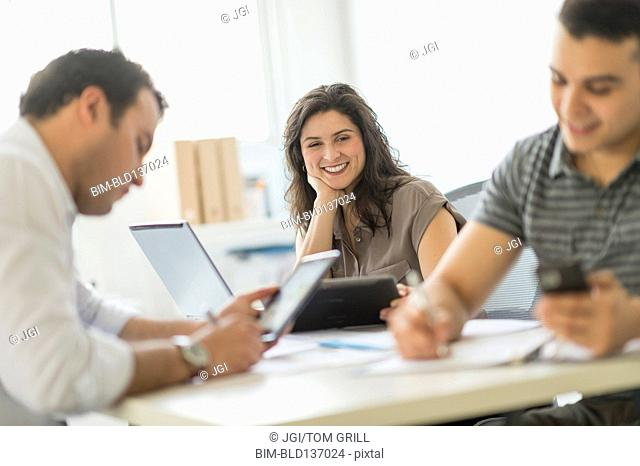 Hispanic business people working in office