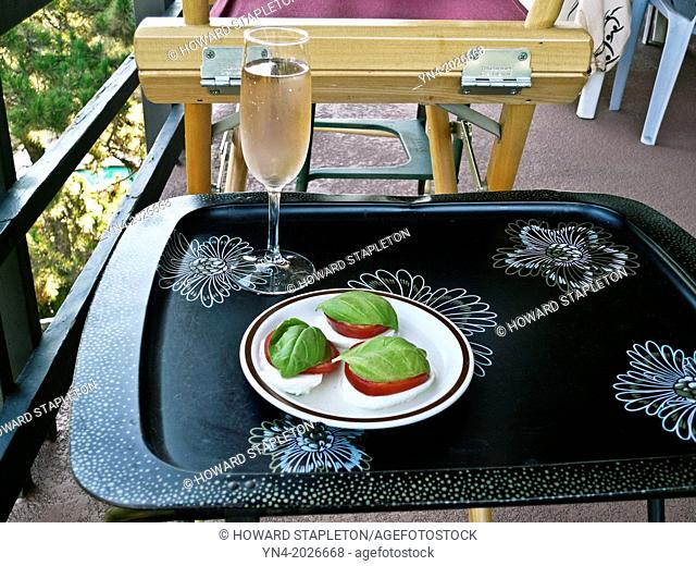 Caprese served outdoors with pink wine