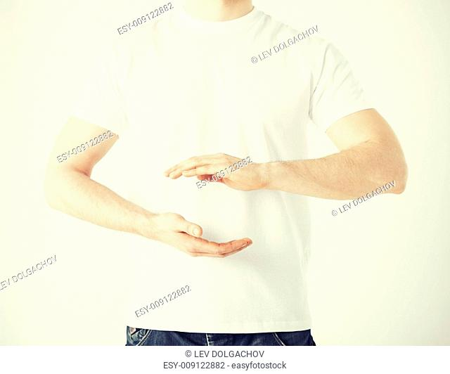 close up of mans hands showing something
