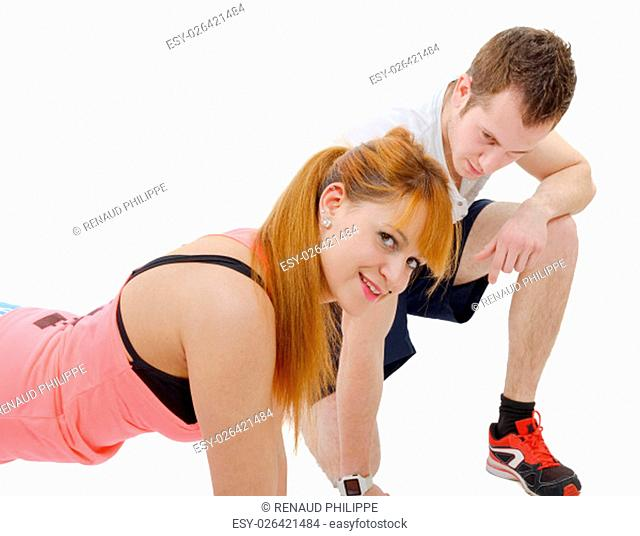 male trainer assisting young woman doing push-up isolated on white background