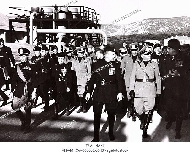 Benito Mussolini and Achille Starace during an official visit to the factories of Trieste, shot 18-19/09/1938 by Demanins, F. A