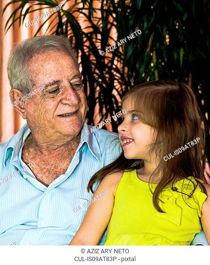 Girl chatting with grandfather