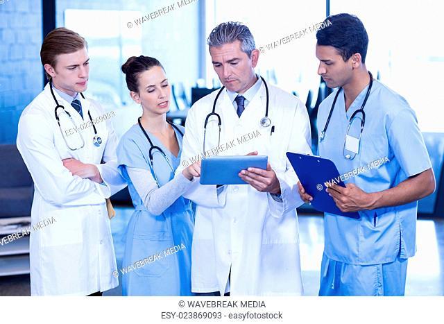 Doctors looking in digital tablet