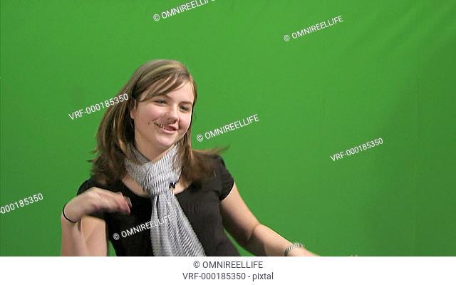 Teenage female dancing in front of green screen