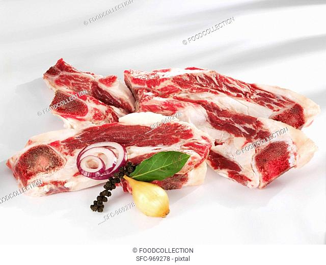 Several slices of beef brisket with bones