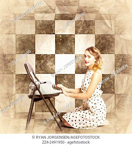 Vintage paper portraiture of a beautiful young fifties woman kneeling inside chequered interior room writing book on old typewriter