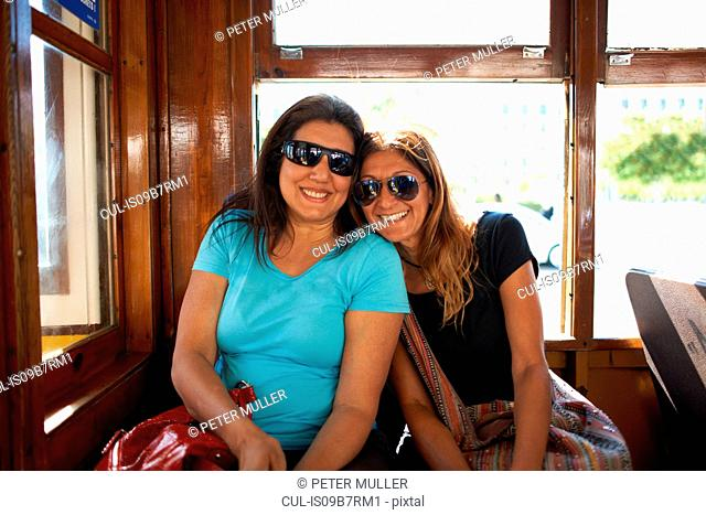 Women travelling on tram, Lisbon, Portugal