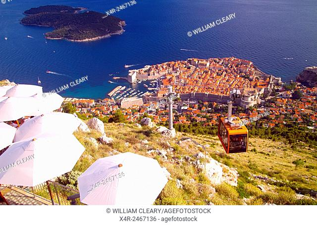 Old town Dubrovnik and Lokrum Island viewed from Srd Hill, with the Dubrovnik Cable Car in the foreground, Dubrovnik, Dalmatian Coast, Croatia