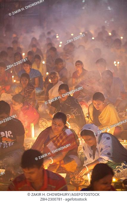 "People of Hindu Community (Bangladeshi) celebrating ""Rakher Upobas†a culture in every Bengali month Kartik. It's a fast day for keeping safe all of own family..."