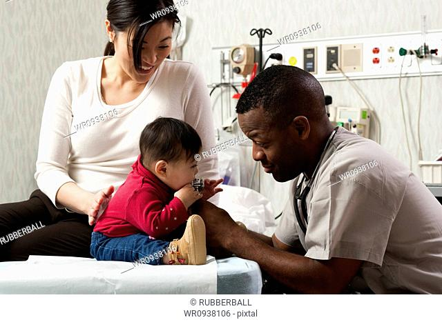 Mother and baby in examining room with doctor