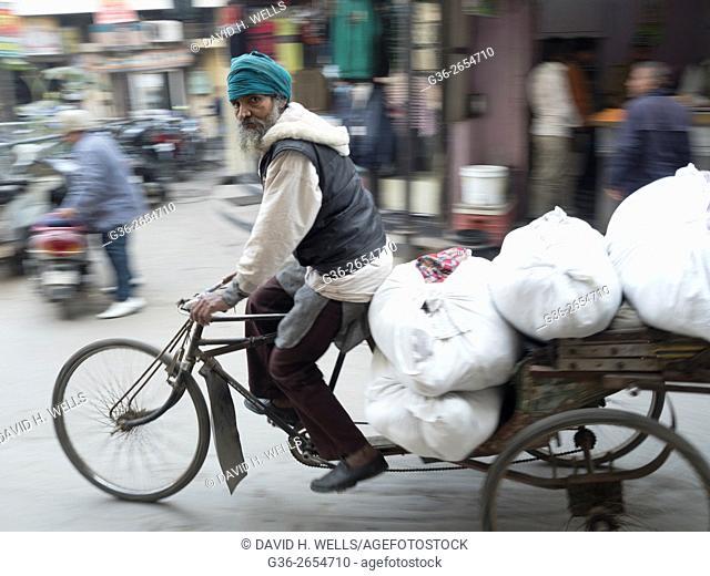 Men riding in rickshaw, Amritsar, Punjab, India