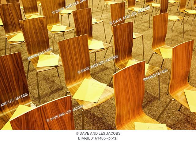 Close up of empty chairs with pamphlets
