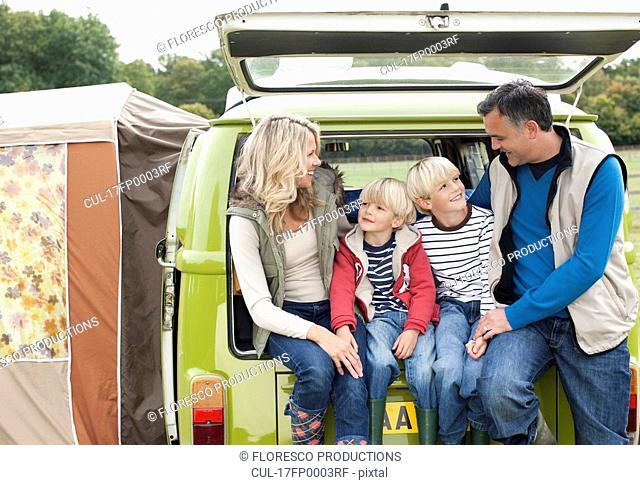 Family at back of camper van