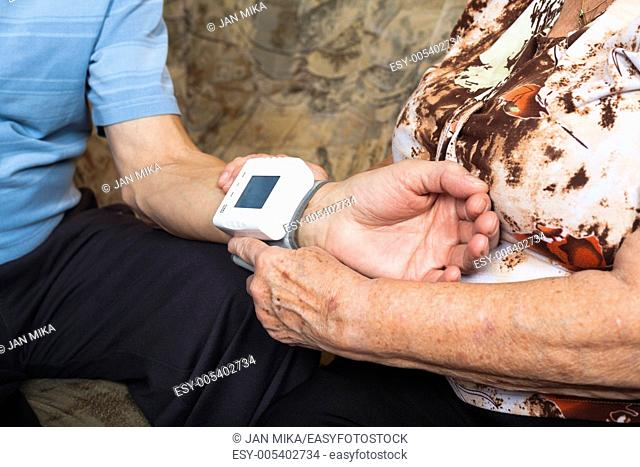 Close up of seniors checking blood pressure