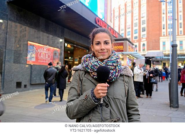 Attractive Television Reporter broadcasting live in Madrid