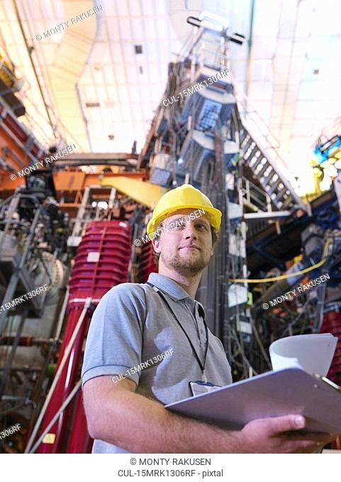 Scientist In Front Of Fusion Reactor