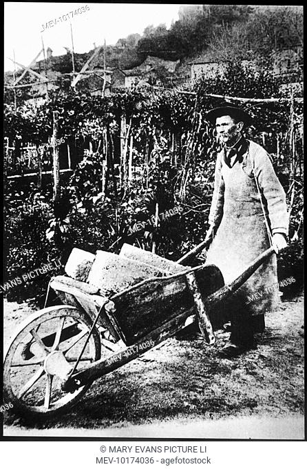 FERDINAND CHEVAL Rural postman and fantastic architect with his trusty wheelbarrow transporting rocks to build his 'Palais Ideal'