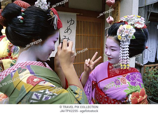 Apprentice Geisha (Maiko) / Women Dressed in Traditional Costume / Kimono, Kyoto, Honshu, Japan