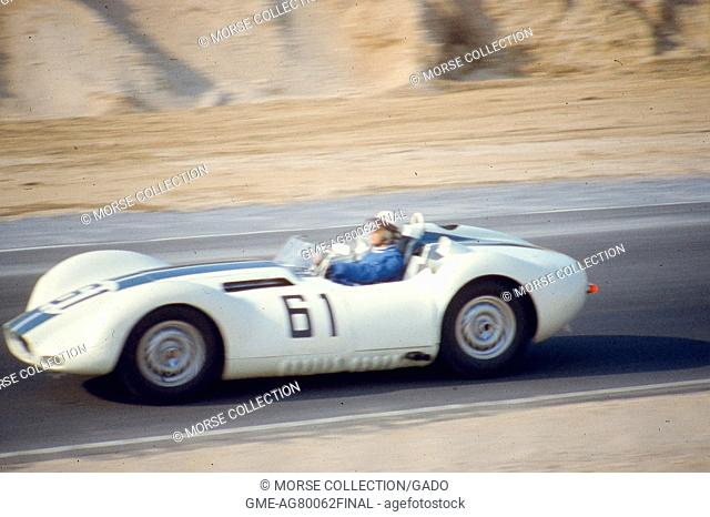 Action view at speed of Mr. Ed Crawford driving the No. 61 Lister-Jaguar Knobbly down the track at the Sports Car Club of America's SCCA National Races in...