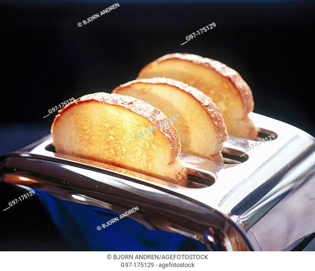 Slices of bread in toaster