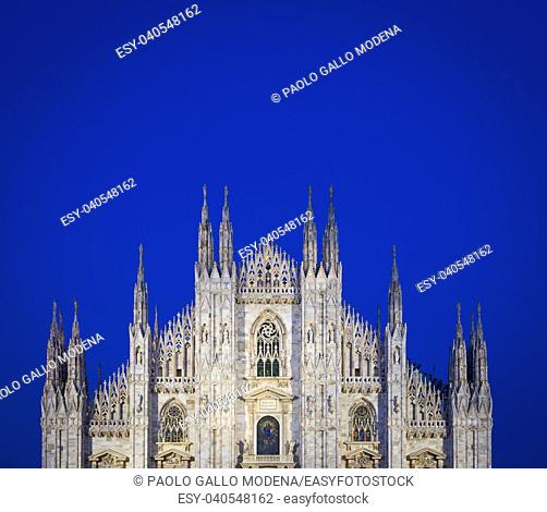 MILAN, ITALY - APRIL 28th, 2018: turists during blue hour taking pictures in Duomo Square , the main landmark of the city