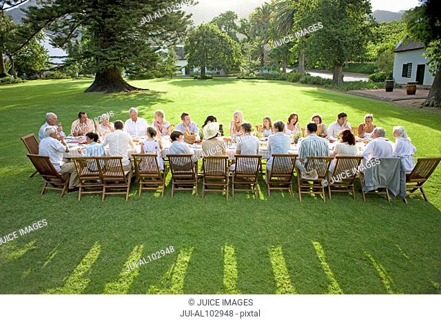 Guests sitting at a table at an outdoor reception