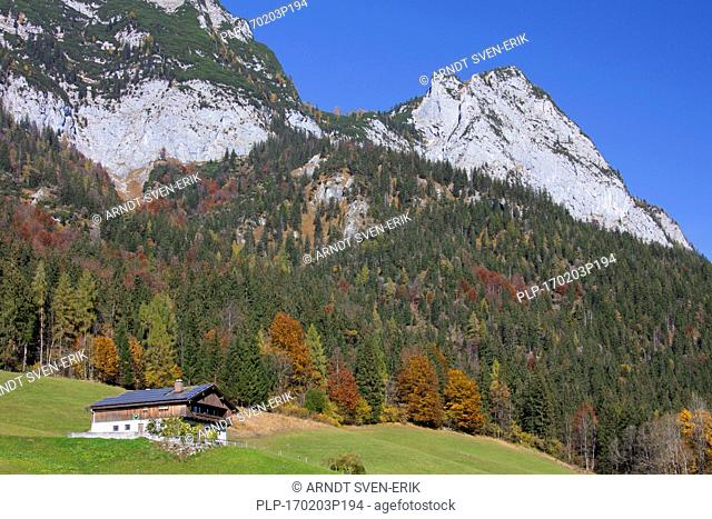 Traditional house with solar panels on roof near Hintersee at Ramsau, Berchtesgadener Land, Upper Bavaria, Germany