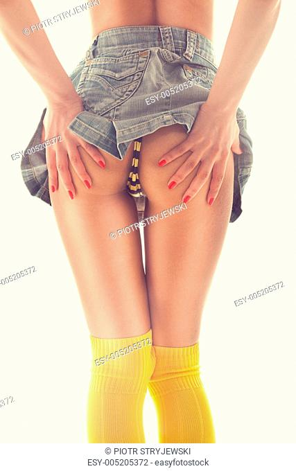 Woman in a miniskirt with backside showing