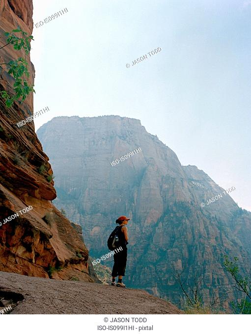 Woman at mountain overlook, Zion National Park, Utah