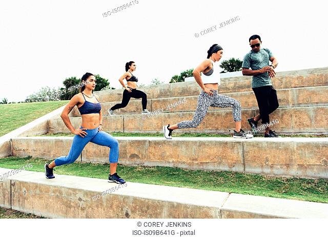 Three women working out with personal trainer, Point Park, Miami Beach, Florida, USA