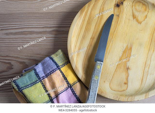 Wooden plate with knife and napkin