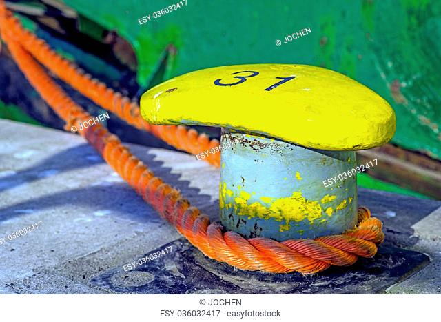 bollard with mooring line of a trawler