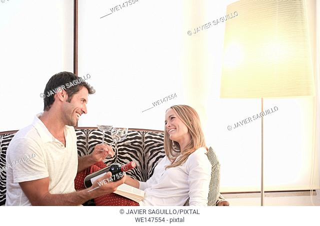 Couple with bottle of red wine