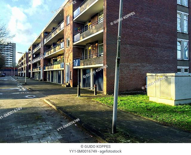 Tilburg, Netherlands. Depressing 1960's apartment building in the city western suburb