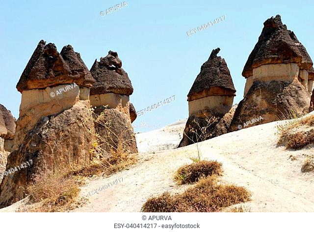 Cappadocia Cave houses and fairy chimneys in central Turkey. These geological features carved out of the terrain by natura forces like wind and rain