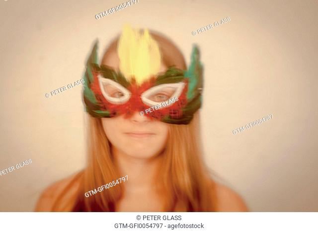 Teenage girl wearing a mask