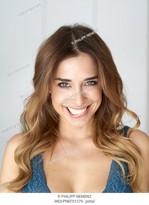 Portrait of beautiful young woman biting on lip