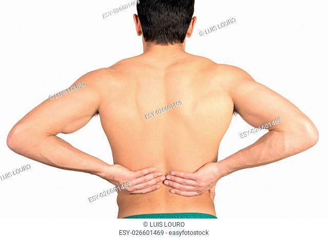 Closeup of young shirtless man with back pain over white background