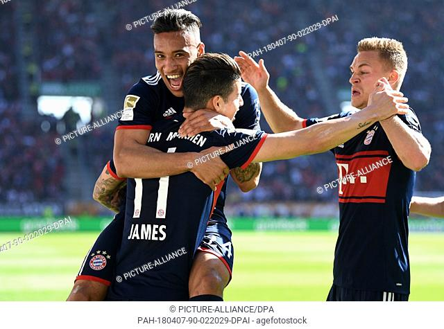07 April 2018, Germany, Augsburg, Soccer: Bundesliga, FC Augsburg vs FC Bayern Munich, in the WWK Arena. Munich's Corentino Tolisso (L-R) celebrating with his...