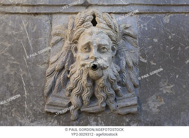 Granada, Spain: Figurehead on the fountain of Charles Vâ. . s Pillar at the Alhambra Palace and Fortress. The three different figureheads of the fountain are...