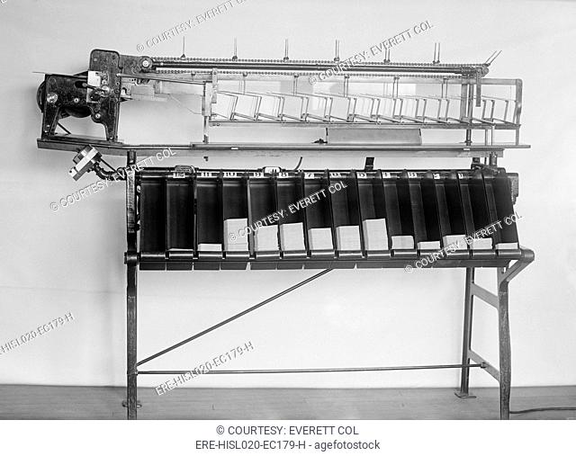 Tabulating machine used in the 1920 United States census. It was a predecessor of electronic computers, and worked by mechanically reading punch cards with...