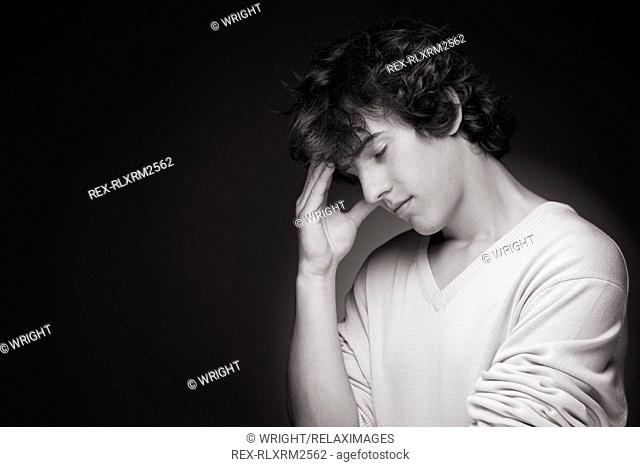 Teenager male thinking depressed black and white