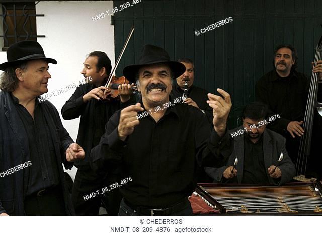 Close-up of musicians playing musical instruments