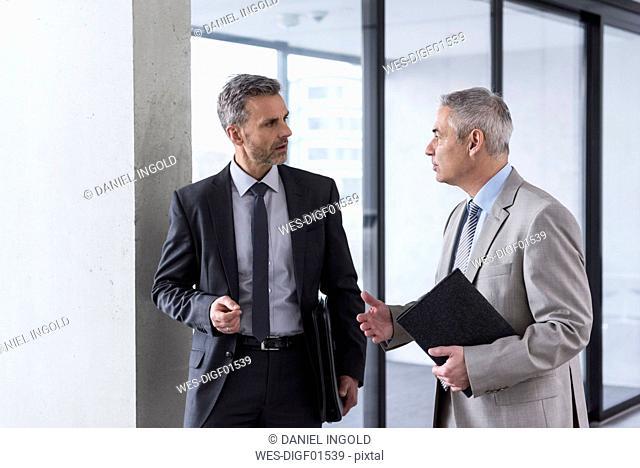 Two businessmen having an informal meeting