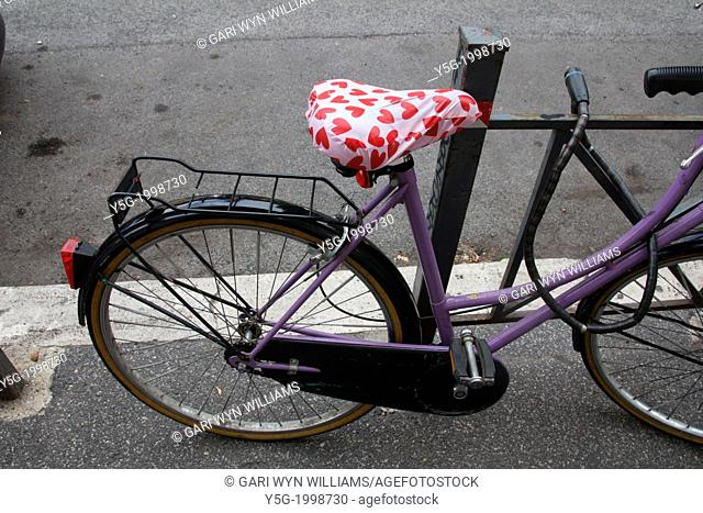 bike with red love hearts saddle in road street in rome italy
