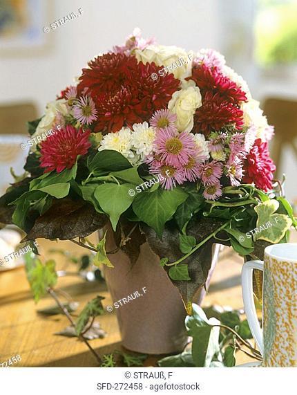 Autumn arrangement of chrysanthemums, white roses & ivy